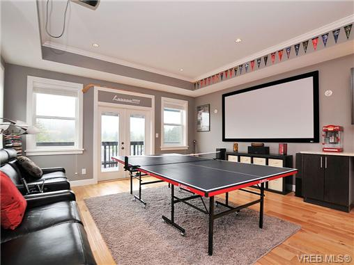 Media room with quality home theatre, balcony with views
