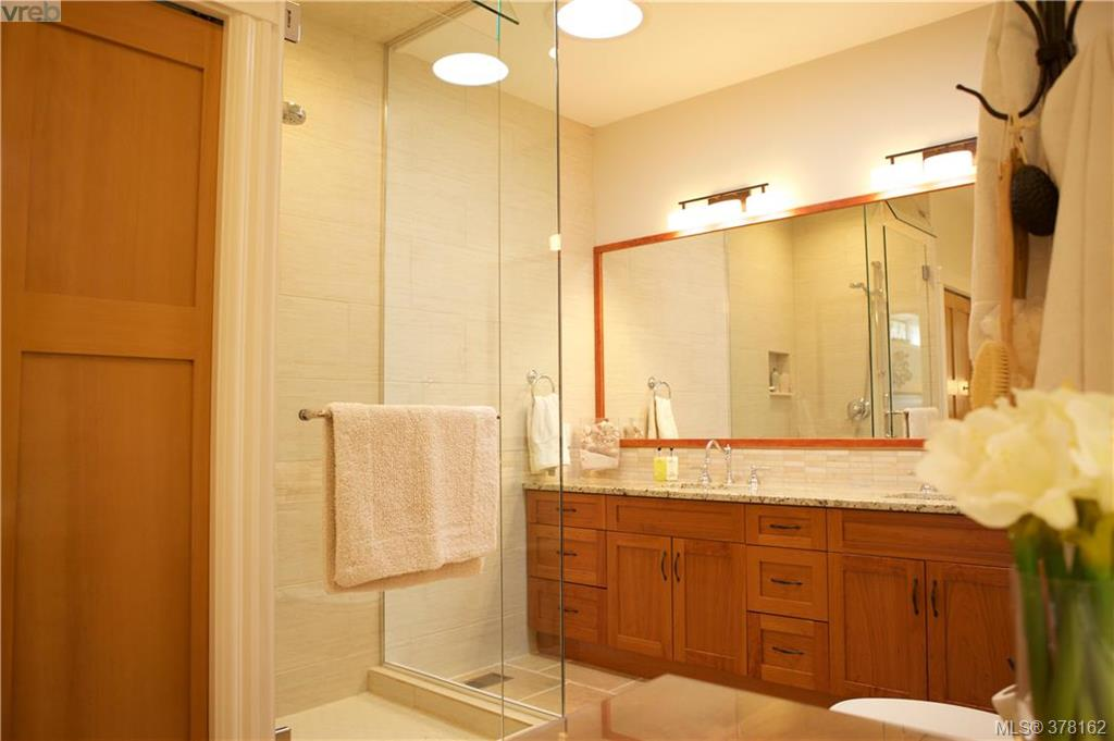 Master Ensuite with double vanity, granite counters,fully enclosed transom shower, heated tile floors and light filled makeup area
