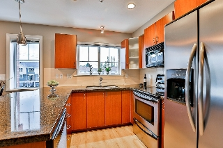 "Main Photo: 207 19730 56 Avenue in Langley: Langley City Condo for sale in ""Madison Place"" : MLS®# R2111415"