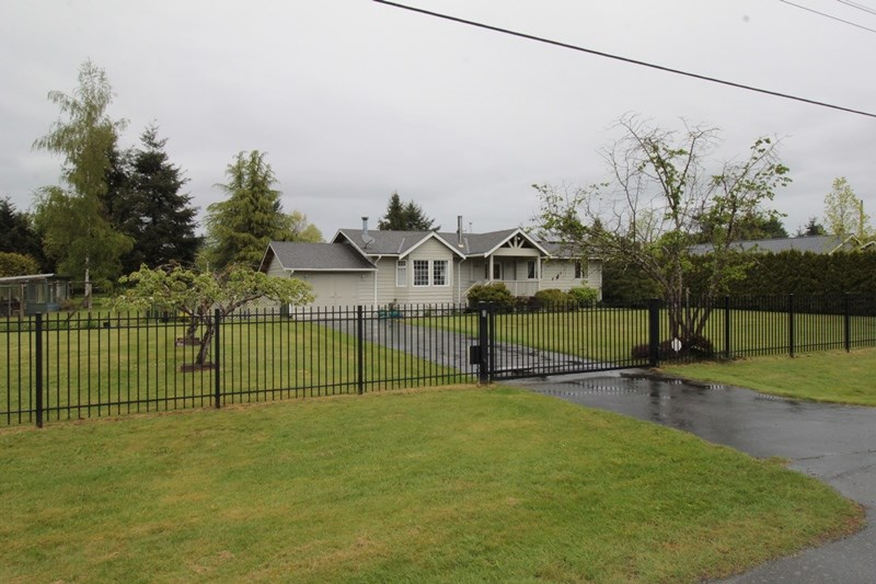 "Main Photo: 24277 58 Avenue in Langley: Salmon River House for sale in ""Strawberry Hills"" : MLS® # R2166829"
