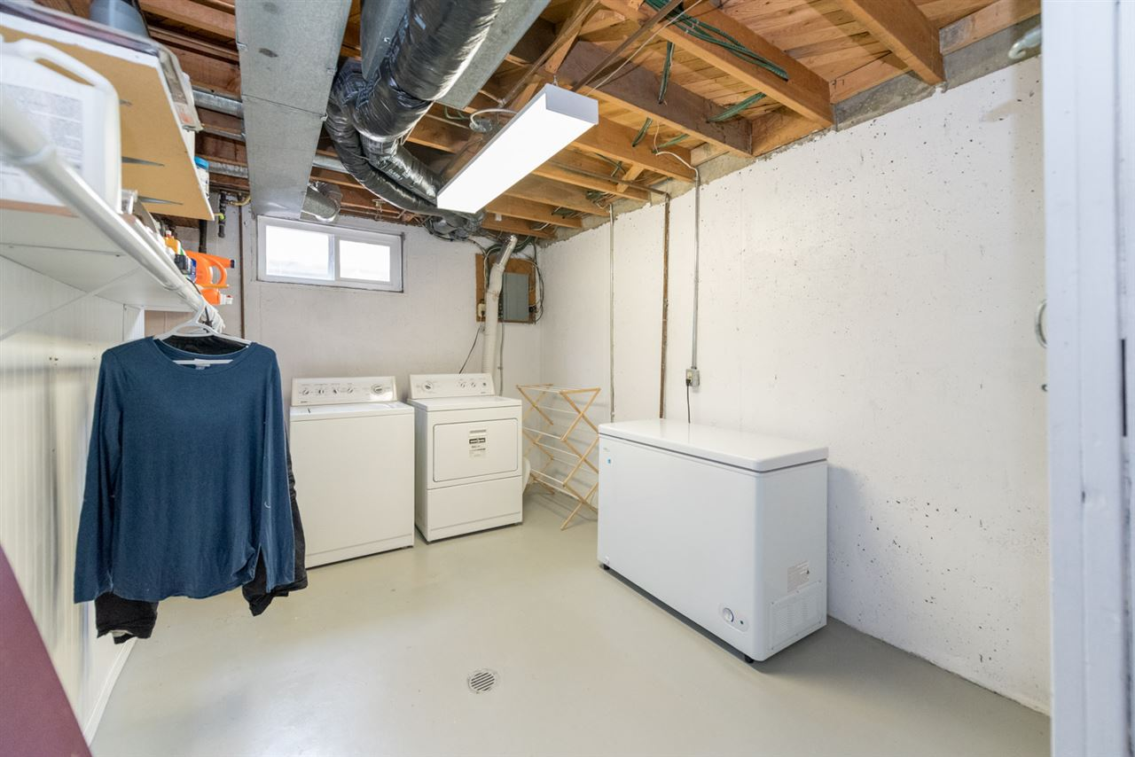 Laundry room with window and storage...