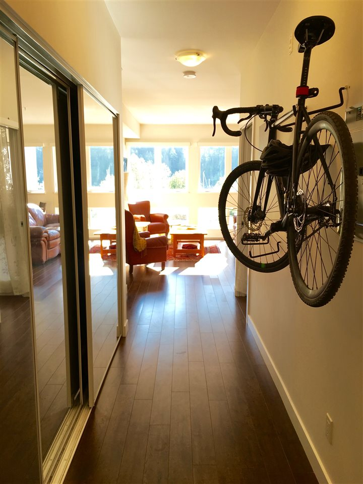 Generous oversized entranceway with triple sliding mirrored doors (concealing great storage space)! Even room to hang a couple of bikes.