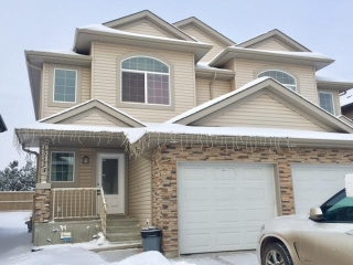 Main Photo: 15724 95 Street in Edmonton: Zone 28 House Half Duplex for sale : MLS(r) # E4046938
