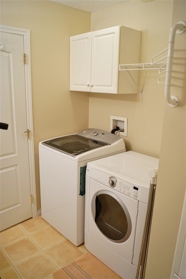 27) Laundry in the 4 piece washroom upstairs