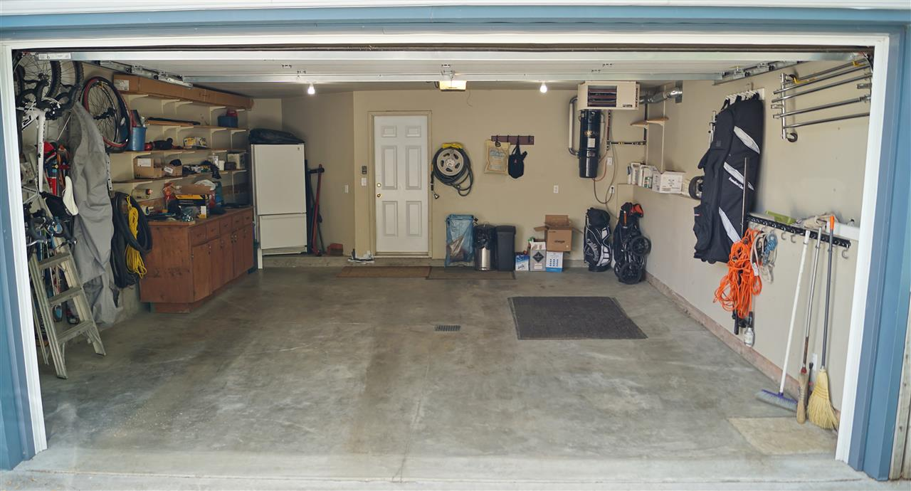 30) Oversized heated double attached garage with additional storage space at front
