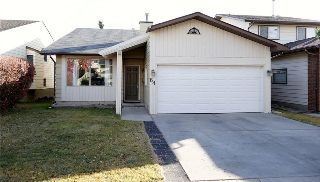 Main Photo: 64 STRATHCONA Close SW in Calgary: Strathcona Park House for sale : MLS® # C4142880