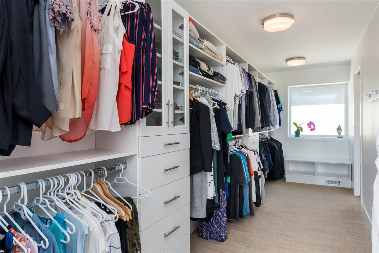 Customized closet with plenty of drawers and storage.