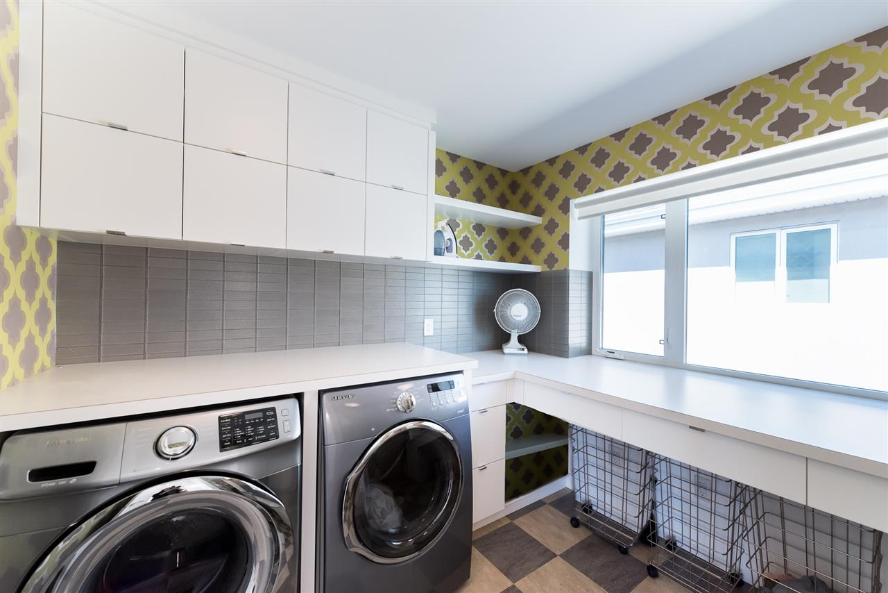 The upper level laundry room boasts plenty of storage including areas large enough to accommodate all your luggage after a big trip.