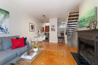 "Main Photo: 2415 W 6TH Avenue in Vancouver: Kitsilano Townhouse for sale in ""Cute Place In Kitsilano"" (Vancouver West)  : MLS(r) # R2129865"