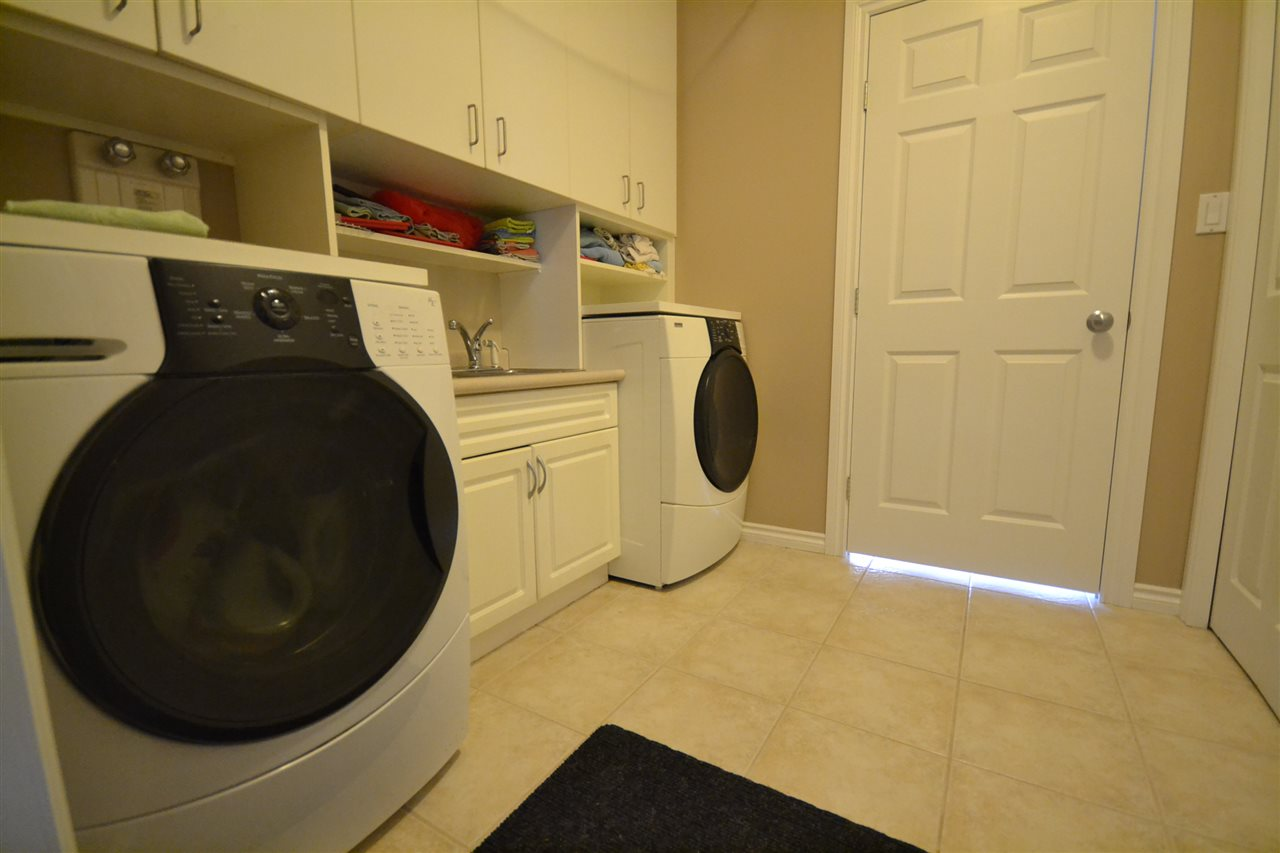 Main floor laundry/utility room. Entrance to heated three car attached garage.