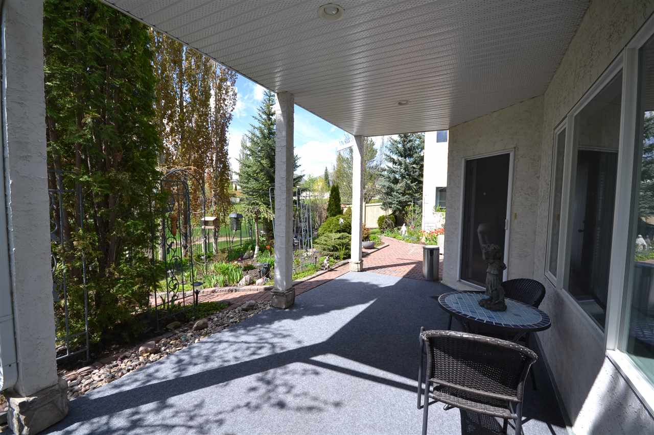 Covered lower patio. Entry to your professionally landscaped oasis back yard! Your rear neighbours are a football field away. Dry Lake bed.