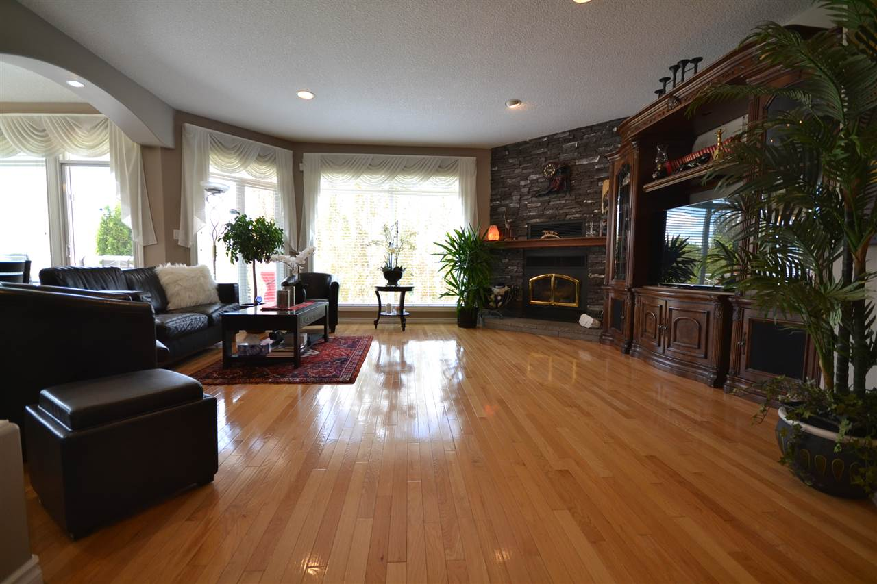 Gleaming hardwood, floor to ceiling windows, recessed lights, wood burning stove.