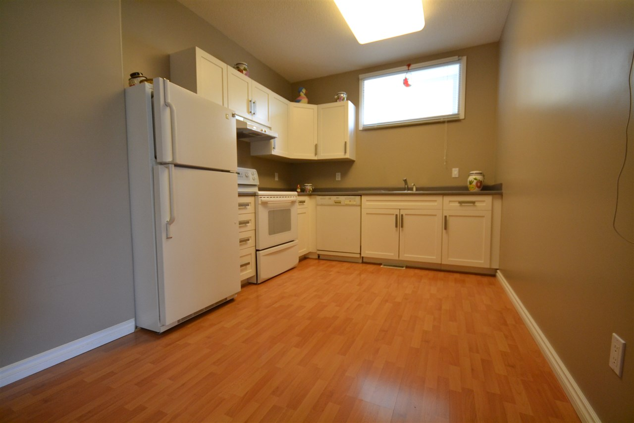 Basement Kitchen. The basement is a walkout with huge windows for a bright open experience. Three bedrooms in the basement. Two and a half baths.