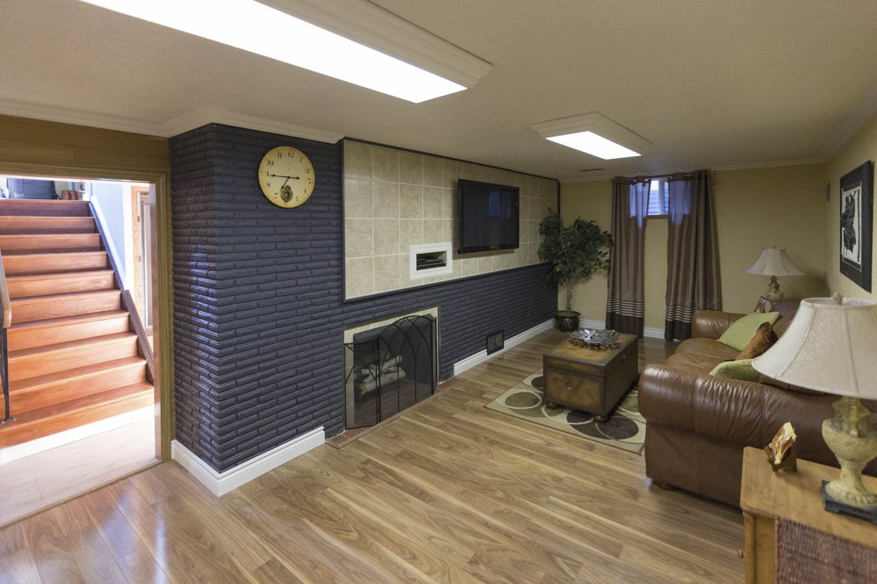 family room in basement with gas fireplace
