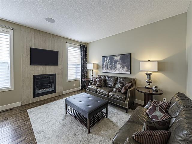 Great room accented by tile finished gas fireplace.