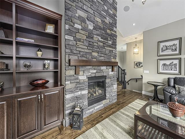 Bonus room with amazing floor to ceiling stone finished gas fireplace.