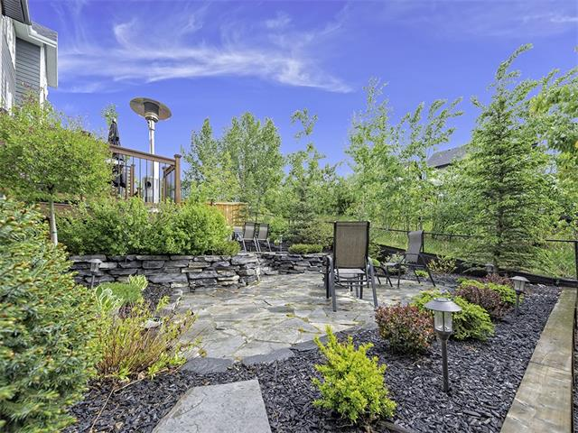 Extensive landscaped multi tiered backyard.