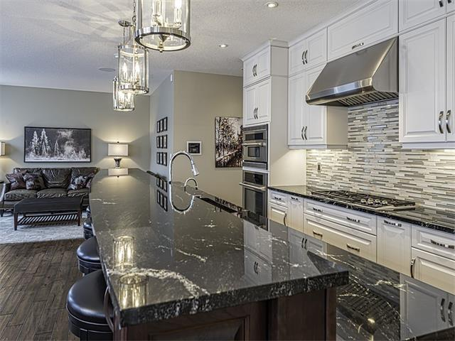 Large island with eating area highlighted by exotic Italian granite counters.