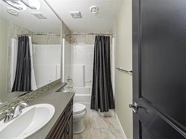 Four piece bathroom in basement.