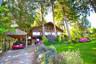 "Main Photo: 6916 MT RICHARDSON Road in Sechelt: Sechelt District House for sale in ""SANDYHOOK"" (Sunshine Coast)  : MLS® # R2085664"