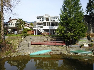 "Main Photo: 1253 RIVER Drive in Coquitlam: River Springs House for sale in ""RIVER SPRINGS"" : MLS(r) # R2148701"