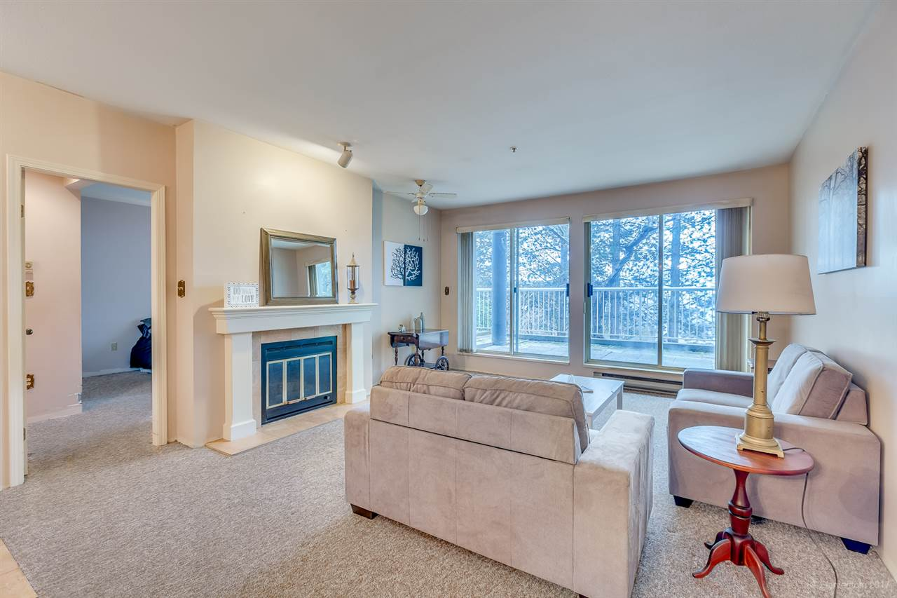 "Main Photo: 101 2733 ATLIN Place in Coquitlam: Coquitlam East Condo for sale in ""ATLIN COURT"" : MLS® # R2154213"