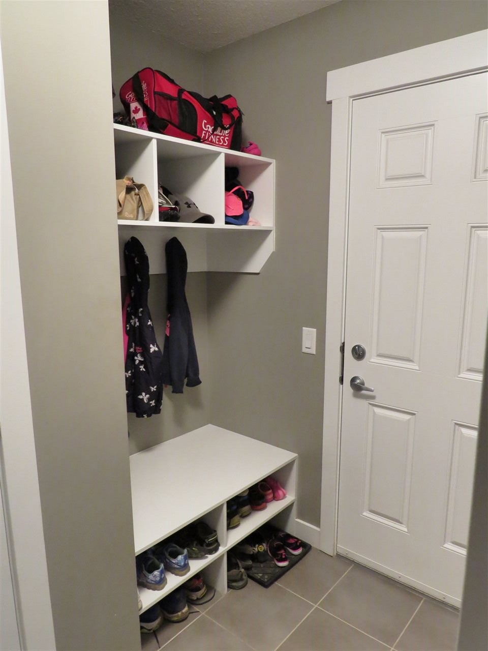 "mudroom entrance with built in storage ""lockers"""