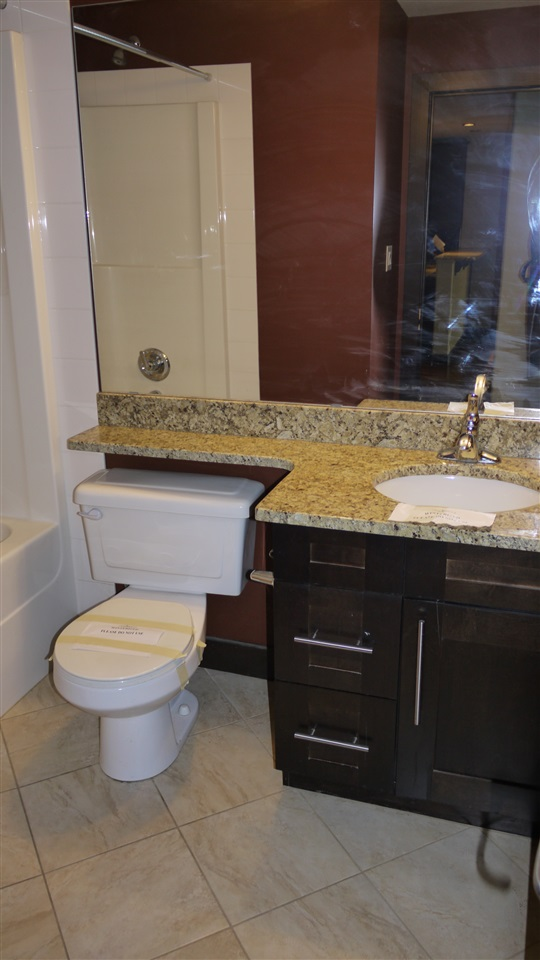 with granite counter tops and ceramic tile on the floor.