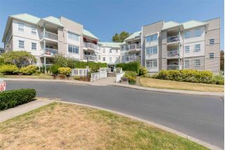 "Main Photo: 302 9767 140 Street in Surrey: Whalley Condo for sale in ""Fraser Gate"" (North Surrey)  : MLS®# R2292847"