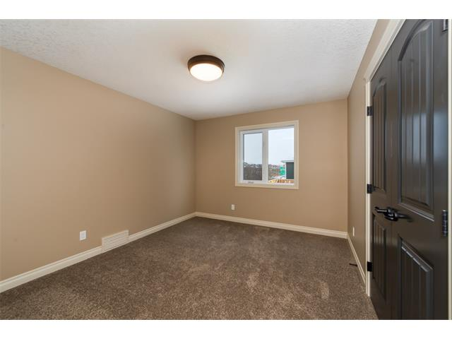 Photo 20: 22 ROCK LAKE View NW in Calgary: Rocky Ridge House for sale : MLS® # C4090662