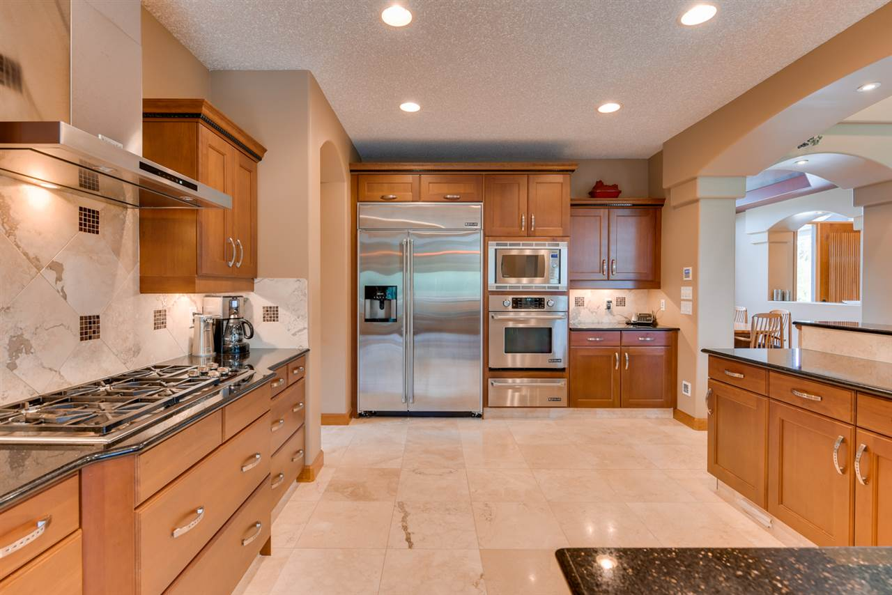 Chef's dream kitchen with large gas range, granite countertops, kraft cherry cabinets, stainless steel appliances,built in wall oven ,warming oven and large pantry with second refrigerator and freezer. Breakfast bar and breakfast nook that open to deck