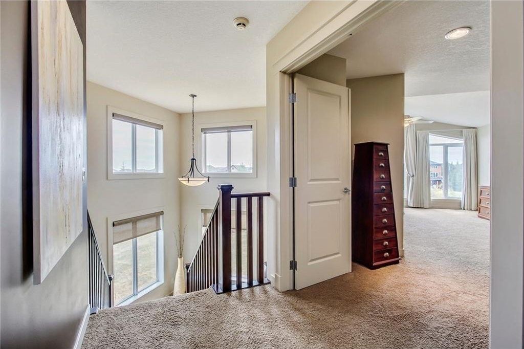 Welcome to the upper level, where you are welcomed by a huge master bedroom with a large walk-in closet and 6 piece ensuite and floor to ceiling windows overlooking the green space.