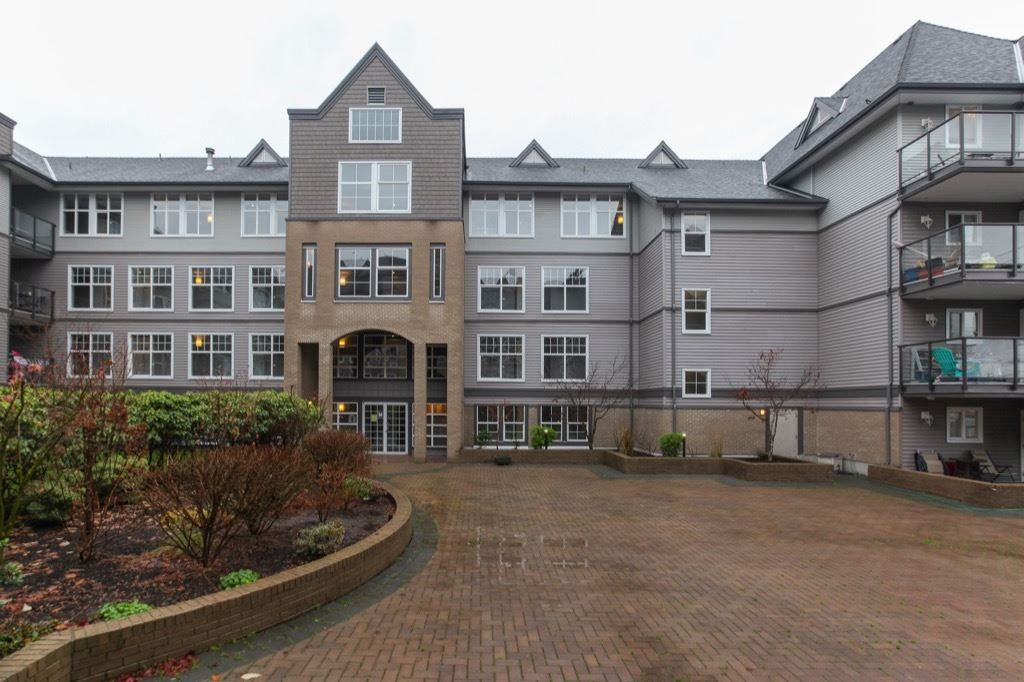 "Main Photo: 101 20200 56 Avenue in Langley: Langley City Condo for sale in ""The Bentley"" : MLS® # R2225726"