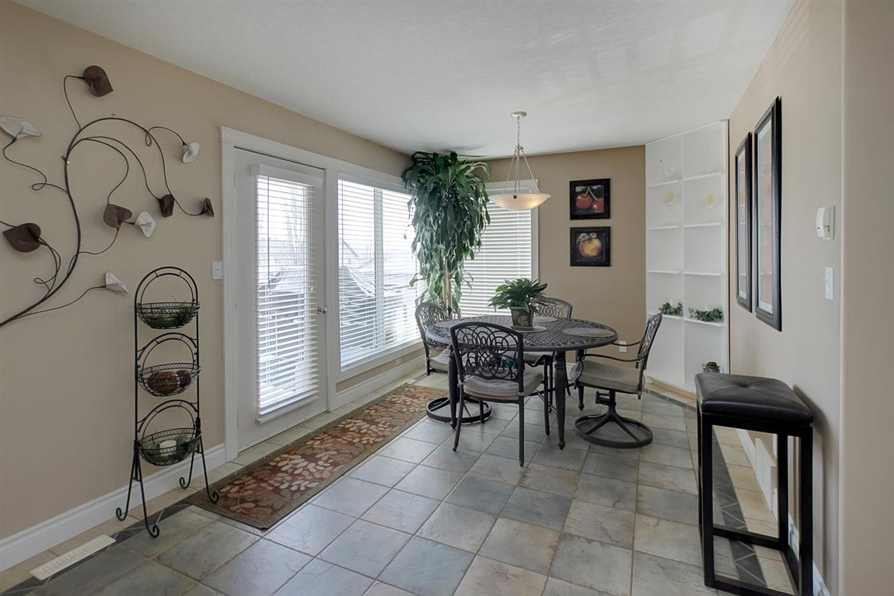 The large breakfast nook offers more designer tile flooring and access to the huge private 2-tier deck.