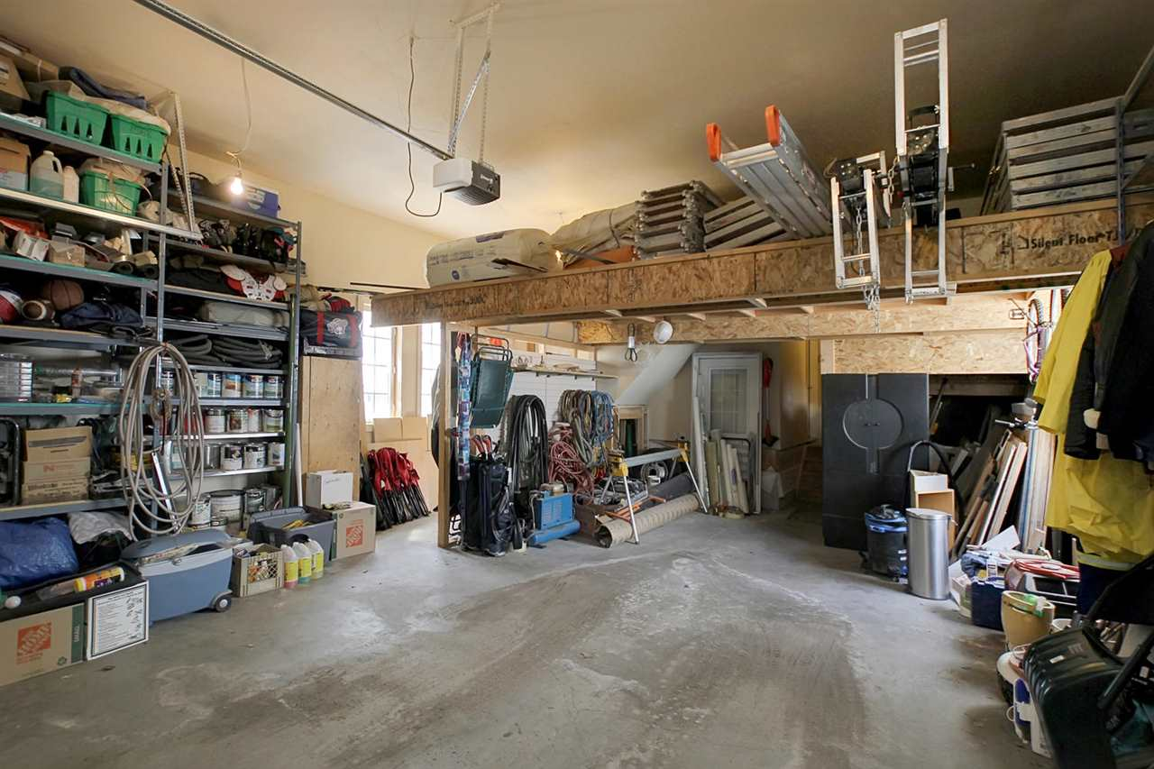 The oversized (24 x 30+ ft) finished garage boasts in-floor heating & a drain. Notice the loads of storage. Also note that there are 2 separate man doors providing access this this very unique garage.