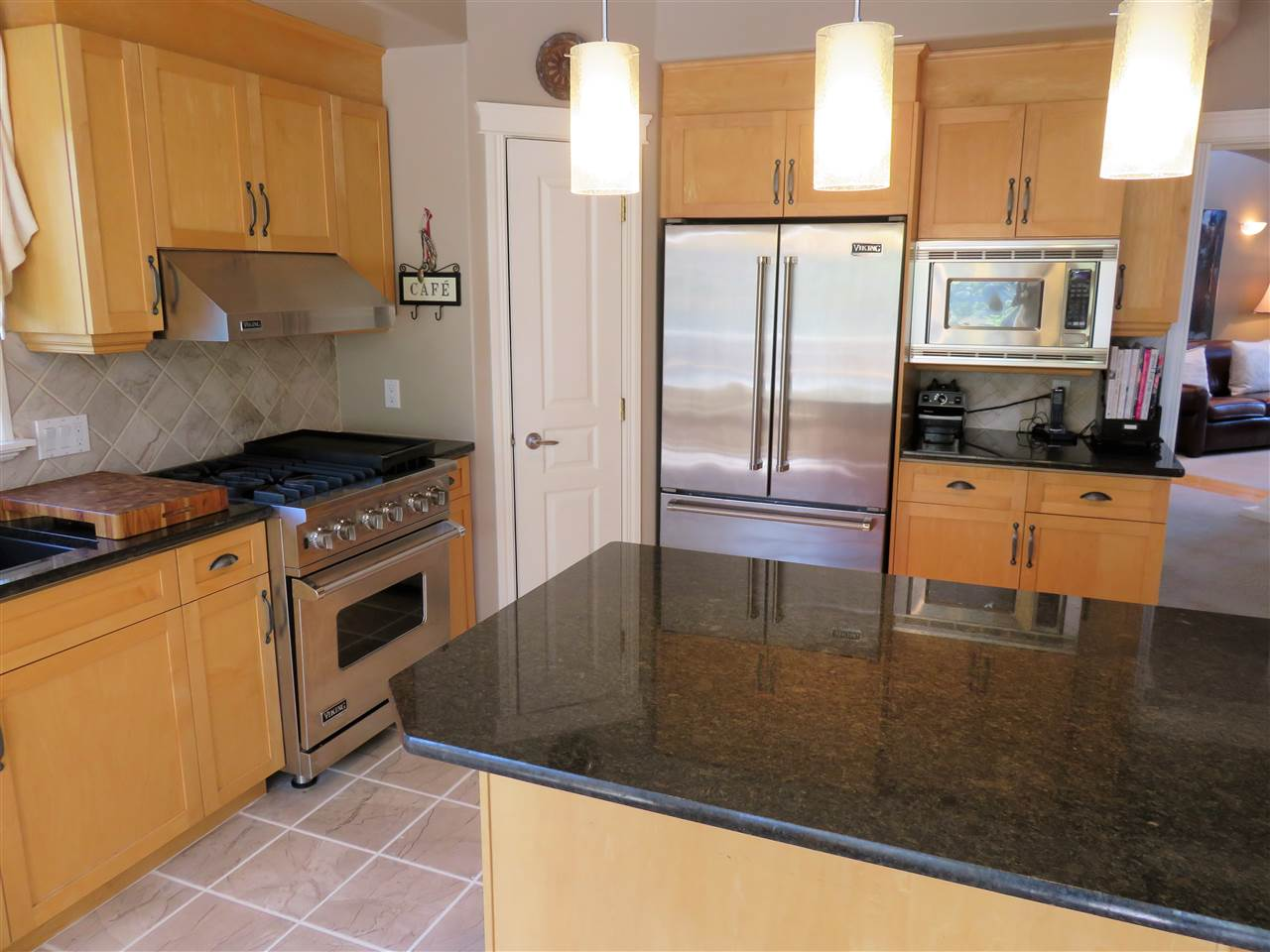 Another view of the beautiful upgraded Kitchen! Note the Gas Stove & large GRANITE ISLAND! :)