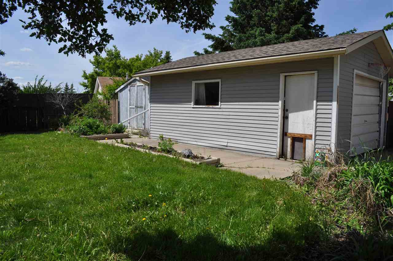 The garage is an oversized single, and makes a great workshop space as well.  The driveway is long enough to park 4 vehicles, and affords RV parking opportunity