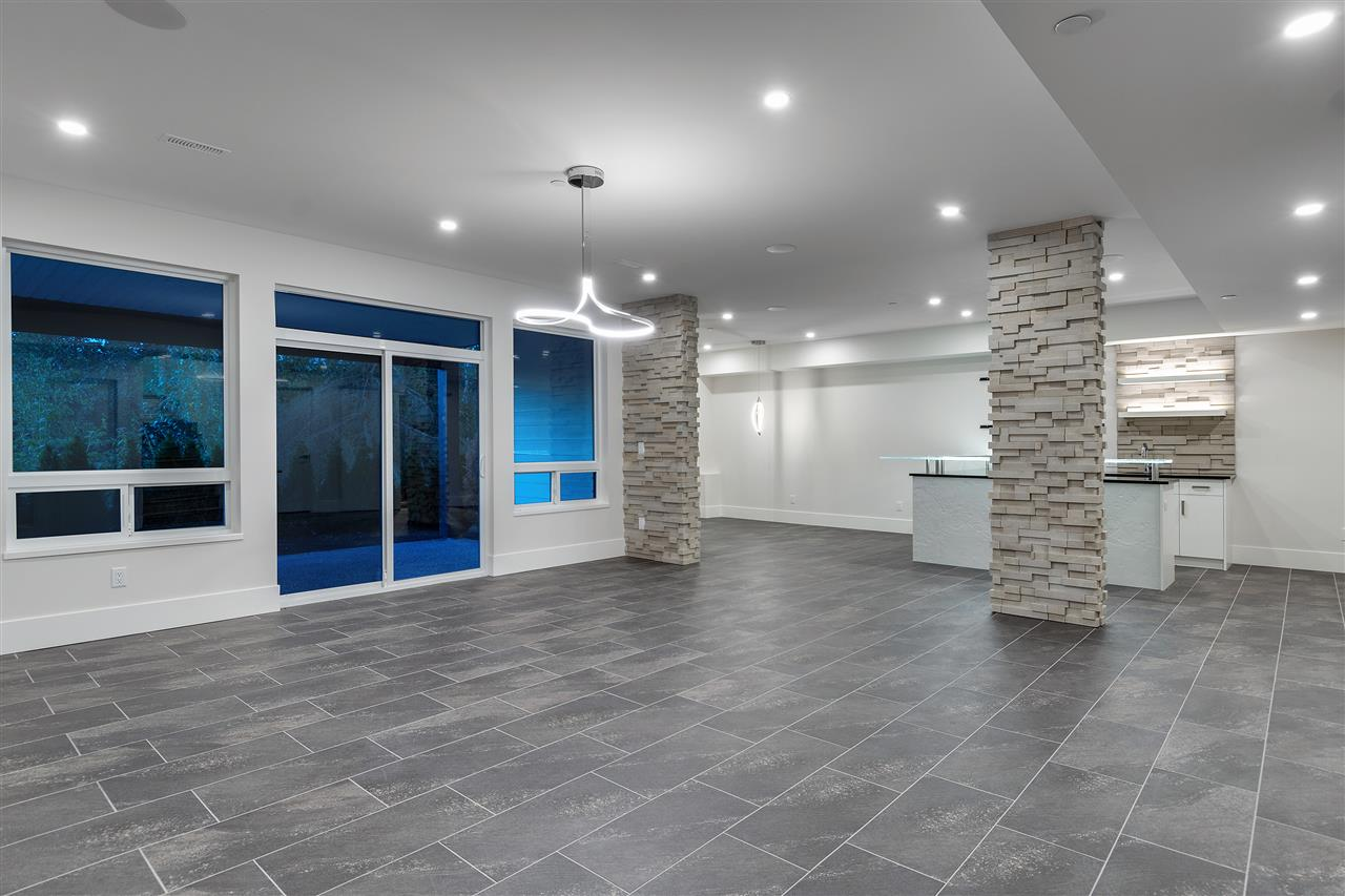 ABOVE GROUND, WALKOUT BASEMENT WITH HIGH CEILINGS AND TONS OF NATURAL LIGHT