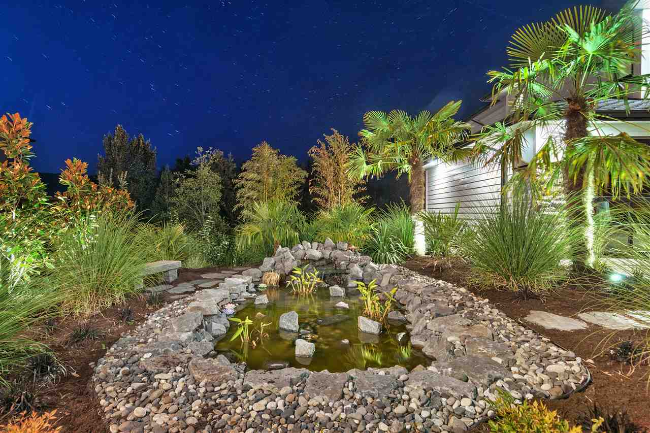 PORFESSIOANLLY LANDSCAPED POND FEATURE