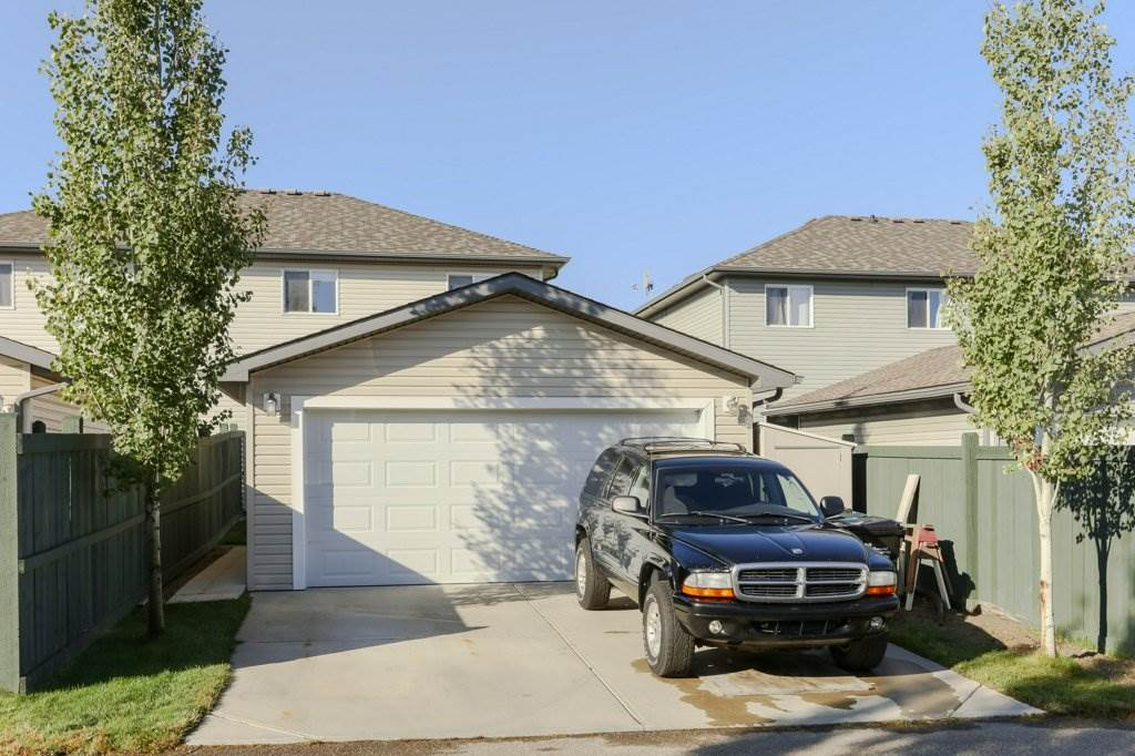 This is the largest size garage allowable on this city lot. This oversized double car garage measures 20 ft x 24ft. The lean-to shed on the right is included for extra storage.