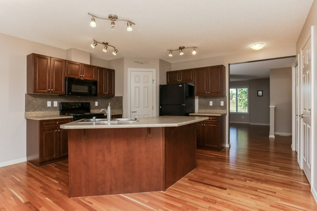 Beautiful cabinetry and hardwood floors, newer appliances and a well laid out cooks triangle offering power and a sink in the island.