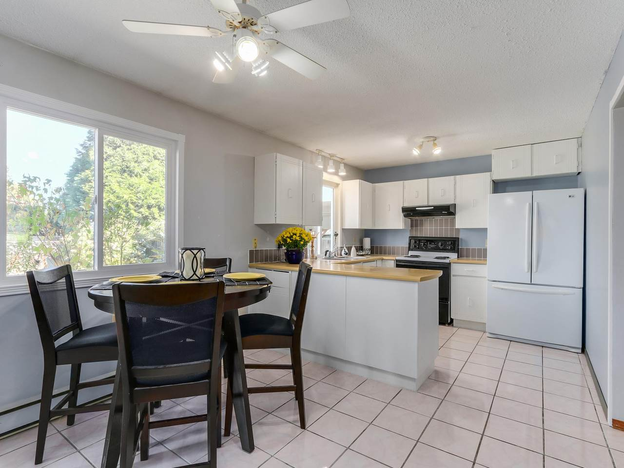 Great working kitchen with lots of counter space. Lots of space for eating area with big picture window looks out to fenced back yard.