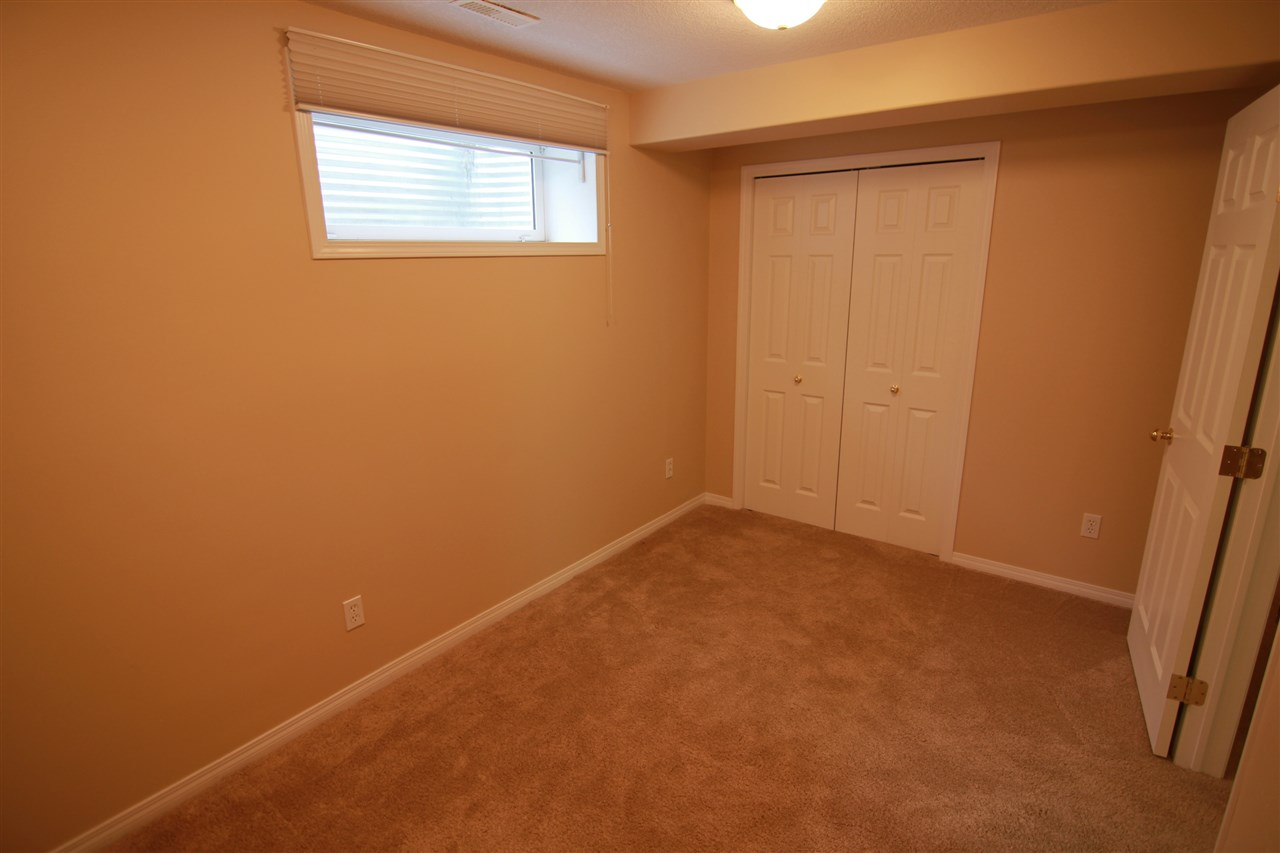This is the third bedroom and is located in the basement, across from a three piece bathroom.
