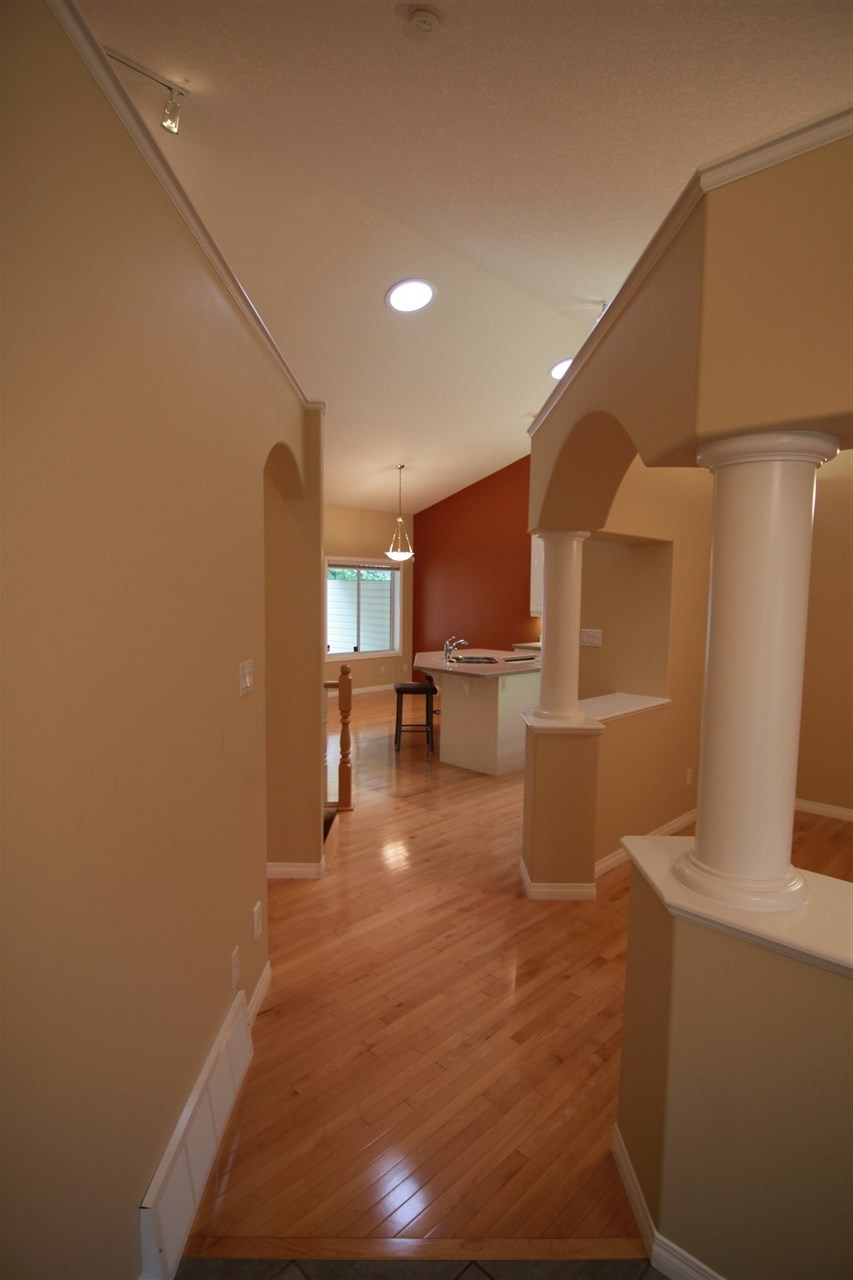 The Hallway leading past the dining room, to the back of the home