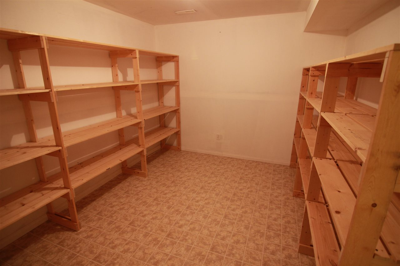 An amazing sized storage room with the shelving included