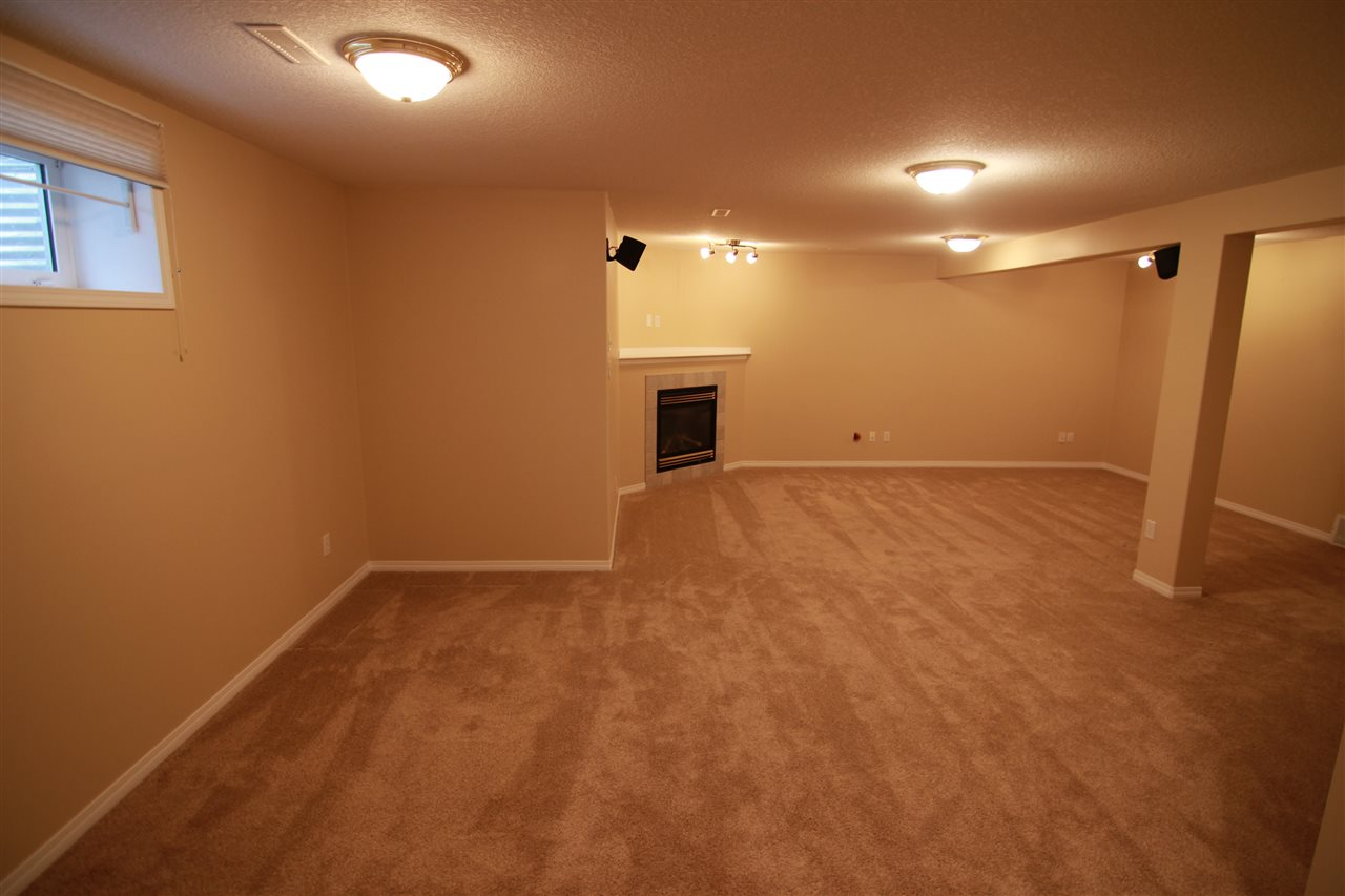 The family room is located in the basement and has wiring for surround sound, which includes two speakers. There is a corner gas fireplace.