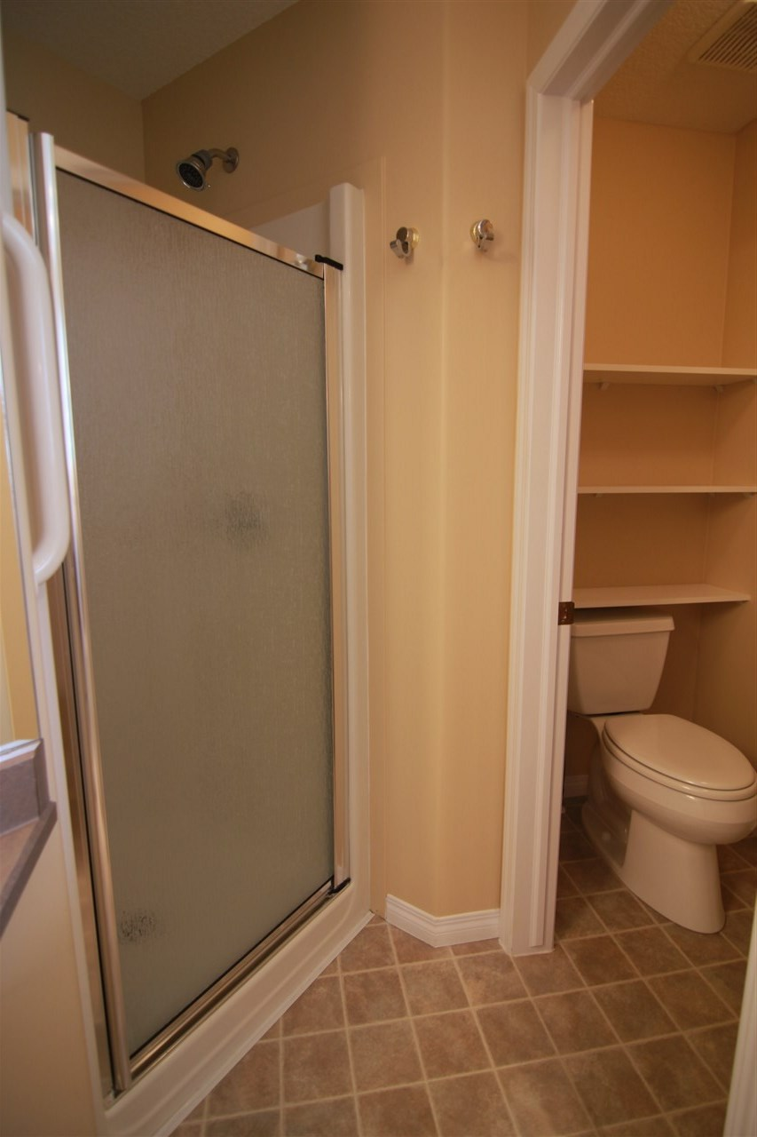 The toilet has a throne room and there is a stand alone shower in the en suite.