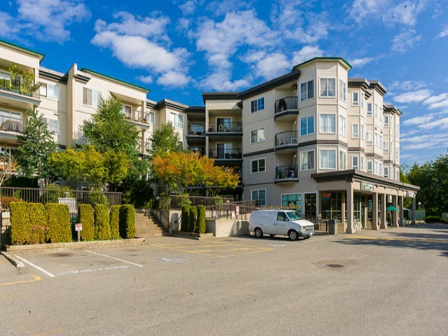 "Main Photo: 406 5765 GLOVER Road in Langley: Langley City Condo for sale in ""COLLEGE COURT"" : MLS®# F1407696"