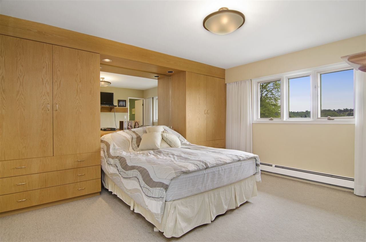 Large master bedroom with built in shelving and VIEW!