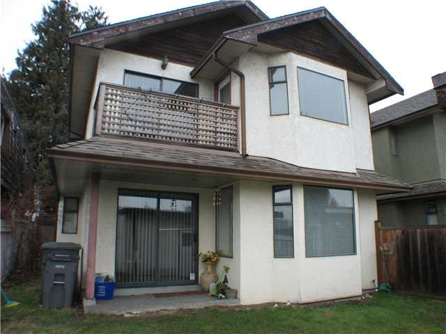 Main Photo: 688 W 70TH Avenue in Vancouver: Marpole House 1/2 Duplex for sale (Vancouver West)  : MLS®# V873153